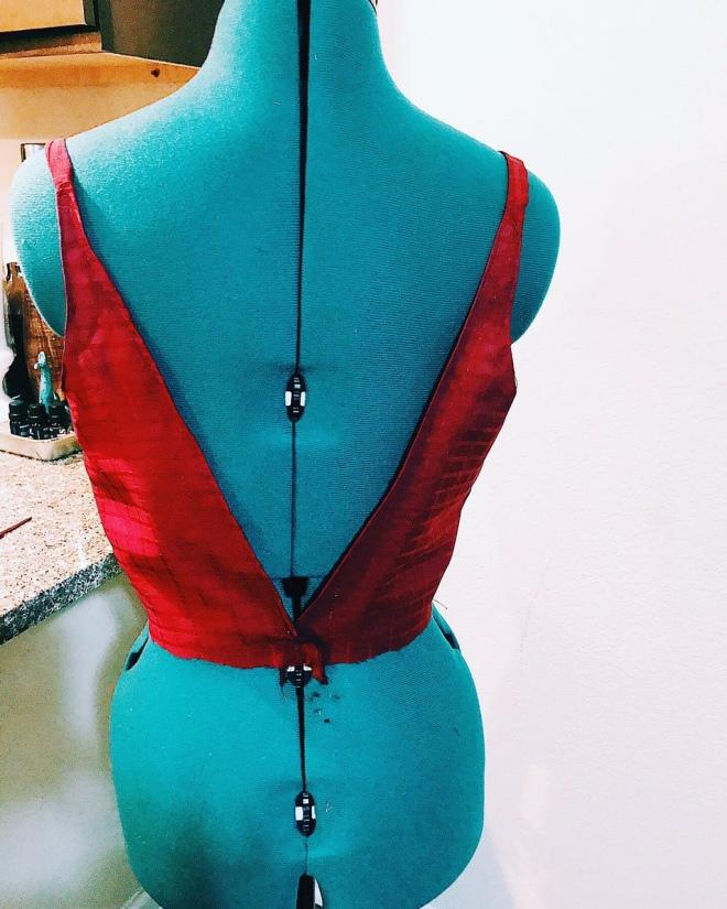 back part of burgundy dress