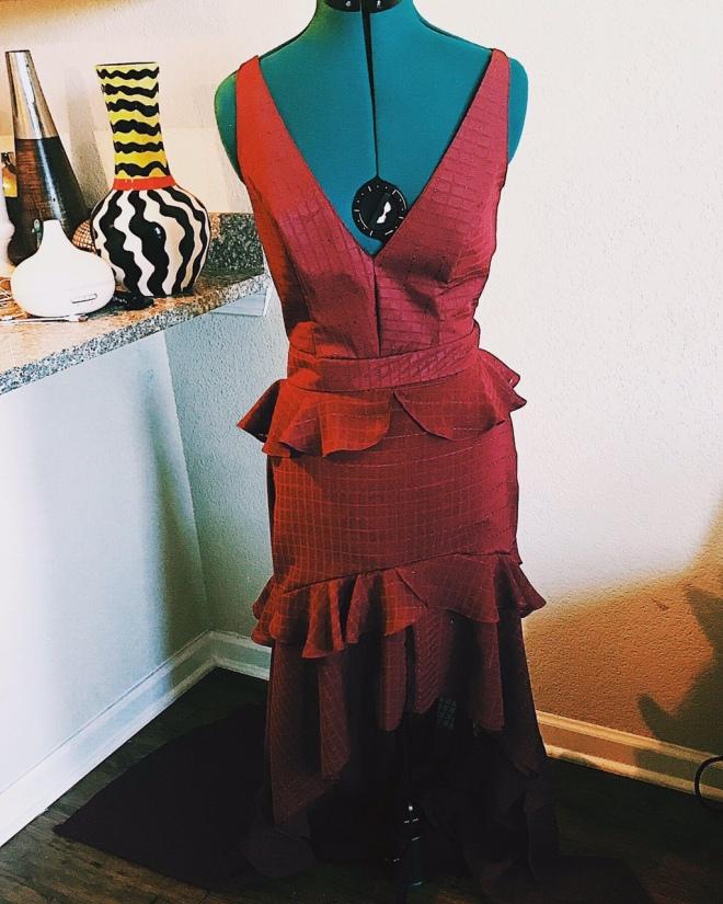 full burgundy dress on mannequin