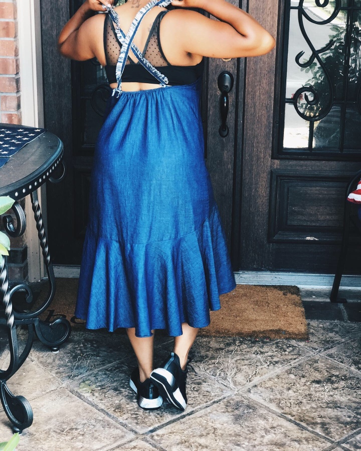 Back of denim dress with Frayed sleeves