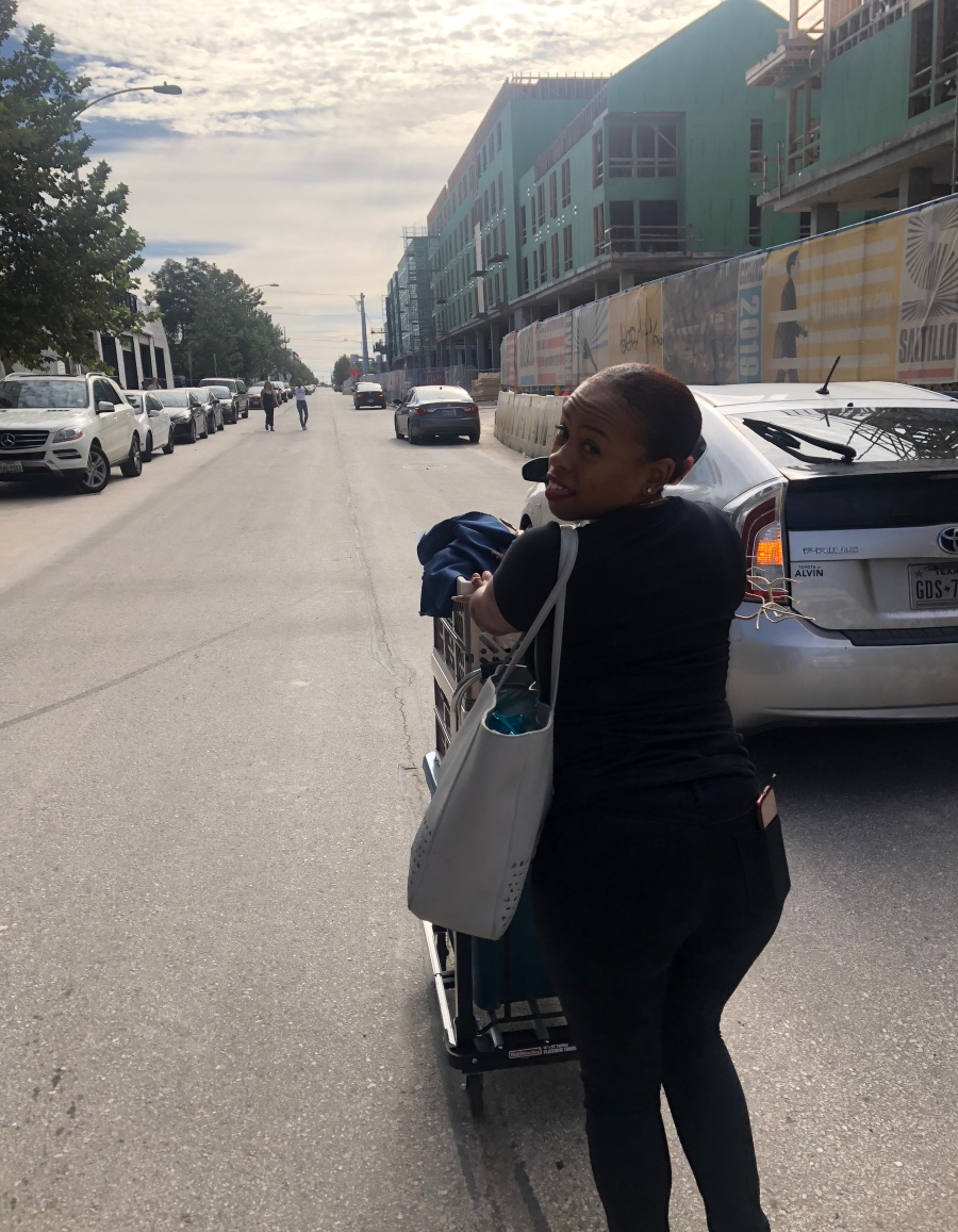 Boutique owner pushing a cart for pop up
