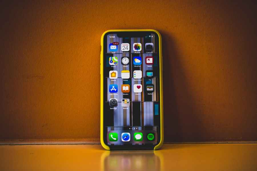turned on iphone x with yellow case