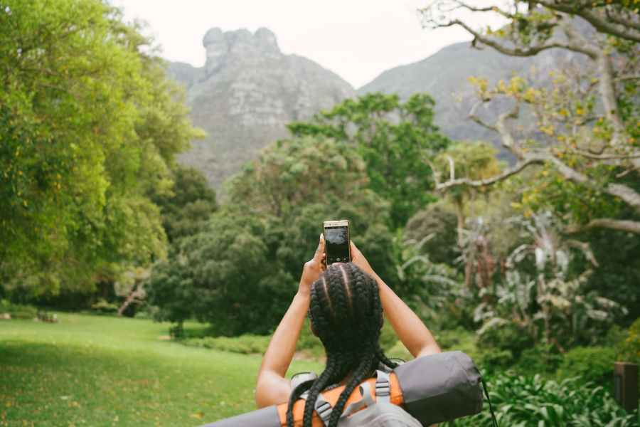 photo of woman taking picture of nature