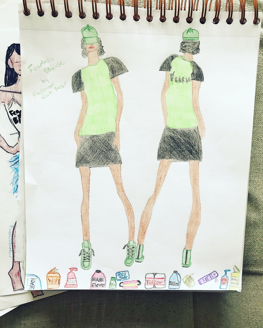 Illustration of green fearless top and black skirt