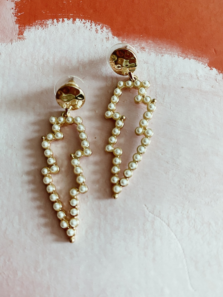 Pearl and gold light being bolt earrings